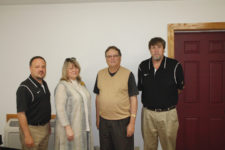 Photo by Greg Bird Superintendent Mike Cash, MCHS Principal Sharon Privett and AD Robert Jones announced the hiring of Jimmy Voight (2nd from right) as new Head Coach for Raiders Basketball this week.