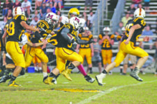 Photo by Chris Hollis Ryan Anderson has some help shaking off a grabby Berea defender during the Raiders' 54-6 win over the Pirates Friday night.